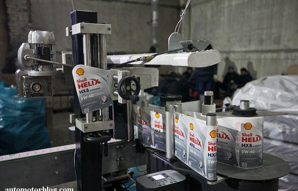 Se întâmplă în Mama Rusie. Fabrică de uleiuri auto contrafăcute cu o rețetă de vis: venituri de 13 milioane de euro pe lună - Poza 13