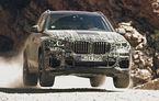 Noua generație BMW X5, testată sub camuflaj în condiții extreme: SUV-ul german va avea direcție integrală și o nouă suspensie