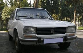 Ofertă de un milion de dolari pentru Peugeot-ul preşedintelui iranian