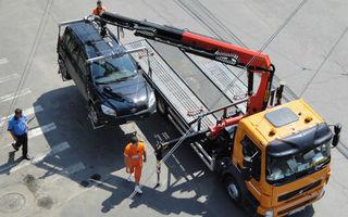 Proiect de lege: maşinile vor putea fi ridicate dacă blochează circulaţia pietonilor pe trotuar