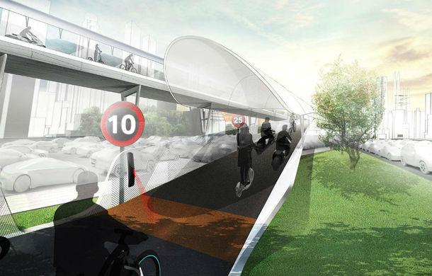 Soluția BMW la problema traficului: drumuri suspendate doar pentru biciclete electrice - Poza 1