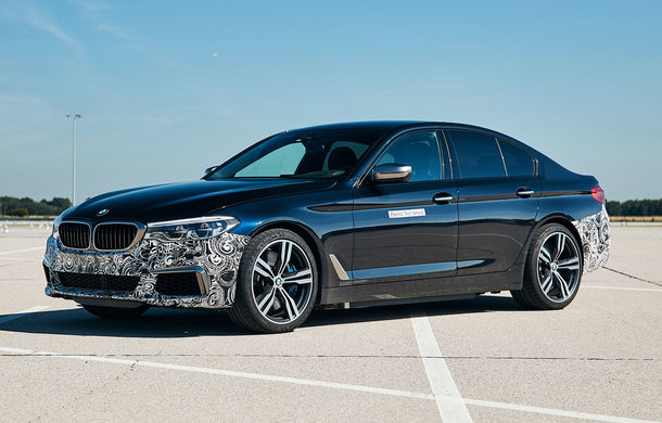 BMW Seria 5 a fost transformat în cobai pentru testarea viitoarelor sisteme electrice de propulsie: trei motoare și peste 720 CP - Poza 1