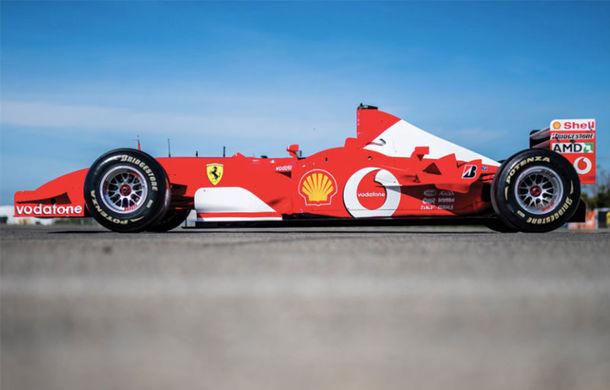 Monopostul Ferrari pilotat de Michael Schumacher în sezonul din 2002 a fost vândut la licitație: suma încasată trece de 6.6 milioane de dolari - Poza 3
