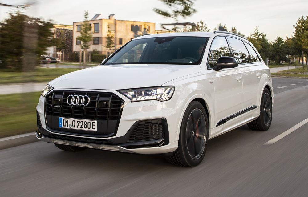 Audi Q7 primește versiuni plug-in hybrid: până la 456 de cai putere și autonomie electrică de 43 de kilometri - Poza 1