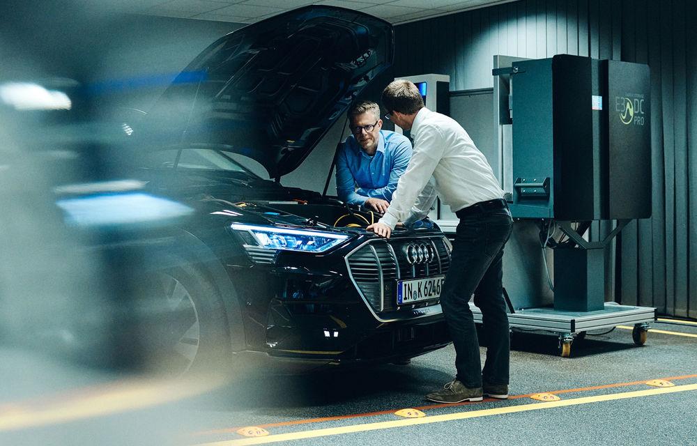 Experiment cu e-tron: Audi dezvoltă o tehnologie prin care mașinile electrice să stocheze și să returneze în rețea energie electrică - Poza 2