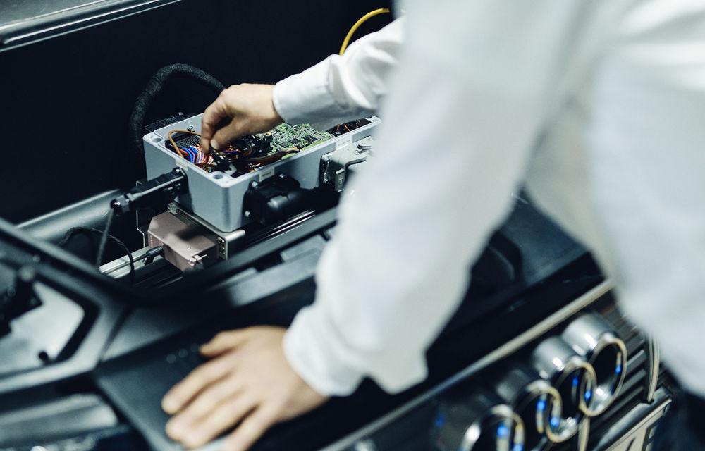 Experiment cu e-tron: Audi dezvoltă o tehnologie prin care mașinile electrice să stocheze și să returneze în rețea energie electrică - Poza 3