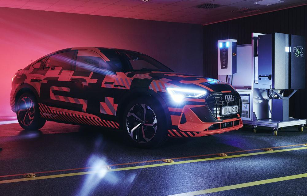 Experiment cu e-tron: Audi dezvoltă o tehnologie prin care mașinile electrice să stocheze și să returneze în rețea energie electrică - Poza 1