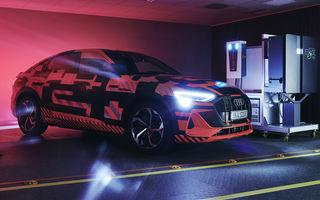 Experiment cu e-tron: Audi dezvoltă o tehnologie prin care mașinile electrice să stocheze și să returneze în rețea energie electrică
